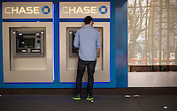 Customer uses the ATM machines at a JPMorgan Chase bank in New York on Sunday, April 28, 2013.  (© Richard B. Levine)