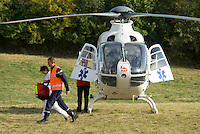Saint Vincent-les-Forts, Lac de Serre Poncon, France, September 2007. A French rescue helicopter lands to transport an injured pilot to the hospital. Volantis is home to the paragliding school Inferno. In one week time, students learn to fly the paraglider and earn their mountain licence 1. Photo by Frits Meyst/Adventure4ever.com