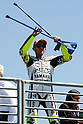 July 25, 2010 - Laguna Seca, USA - Fiat-Yamaha's Valentino Rossi shows his crutches to an audience after the U.S. Grand Prix held on July 25, 2010.  (Photo Andrew Northcott/Nippon News)