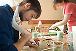 John Robertsno (Left) and Kim Fisher create Stocker Center out of gingerbread . Photo by Ben Siegel