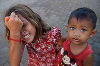 Children at Phnom Penh River side, Cambodia