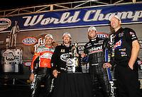 Nov. 13, 2011; Pomona, CA, USA; 2011 NHRA champions (from left) Eddie Krawiec , Del Worsham , Matt Hagan and Jason Line celebrate following the Auto Club Finals at Auto Club Raceway at Pomona. Mandatory Credit: Mark J. Rebilas-.