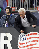 New York Red Bulls coach Hans Backe pounds the boards. Despite a red-card man advantage, in a Major League Soccer (MLS) match, the New England Revolution tied New York Red Bulls, 1-1, at Gillette Stadium on September 22, 2012.