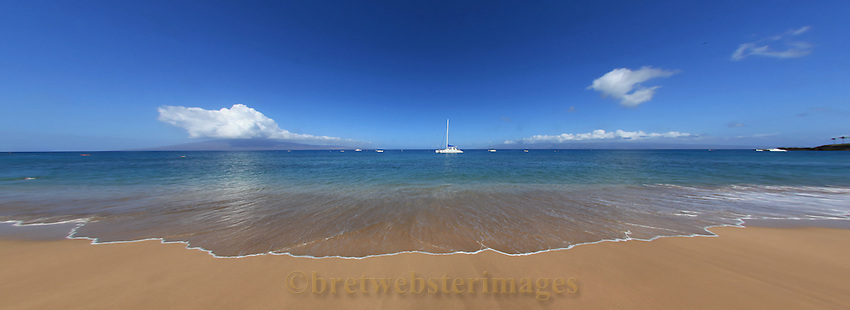 Maui beach scene reminds you where you really oughta be instead of where you are.