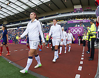 Glasgow, Scotland - Saturday, July 28, 2012:  Alex Morgan and Abby Wambach  of the USA Women's soccer team walk onto the field before a 3-0 win over Colombia in the first round of the Olympic football tournament at Hamden Park.