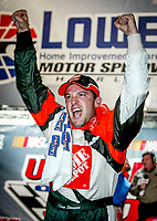 Tony Stewart, winner, victory lane, UAW-GM Quality 500, Charlotte Motor Speedway, Charlotte, NC, October 11, 2003.  (Photo by Brian Cleary/bcpix.com)
