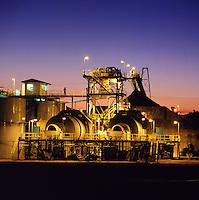 Supervisor checks gold processing plant. Zimbabwe