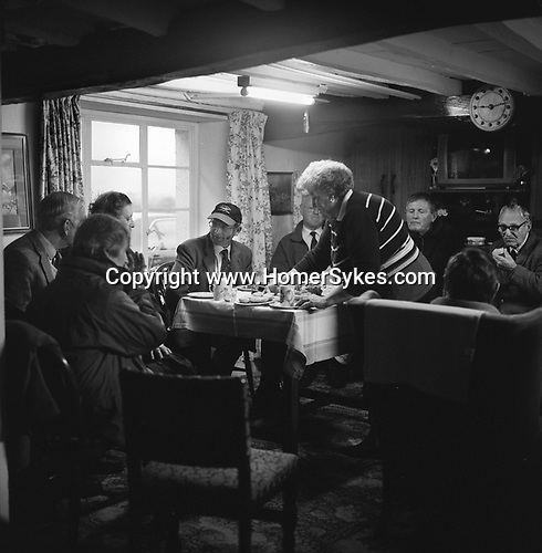 The Blencathra Foxhounds. Coffee, cake and biscuits are provided by Mrs Dorothy Roper in her kitchen. Hall Garth Farm, Near Braithwaite, Cumbria. ..Hunting with Hounds / Mansion Editions (isbn 0-9542233-1-4) copyright Homer Sykes. +44 (0) 20-8542-7083. < www.mansioneditions.com >.