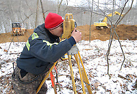A surveyor for International Coal Group measures the placement of a vent hole to be drilled into Sago mine near Buckhannon, WV, Saturday, Jan. 7, 2006, where 12 miners were killed in an explosion in the ICG mine Monday. (Photo by Gary Gardiner)<br />