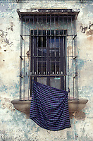 Barred window of an old Spanish colonial house in Antigua, Guatemala