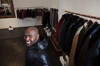 NEW YORK, NY – January 29, 2014: Aspiring fashion designer Brett Johnson with his clothing line, the Brett Johnson Collection, in New York, NY on January 29, 2014. Son of BET's Bob and Sheila Johnson, DC native Brett Johnson is launching his career with a men's apparel line.
