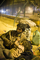 Govardhan lays down with his youngest son beneath the IIT flyover where their family sleep.