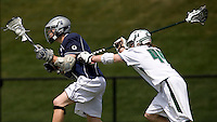 Rickey Morabito (6) of Georgetown tries to get past Steve Dircks (44) of Loyola at the Ridley Athletic Complex in Baltimore, MD.  Loyola defeated Georgetown, 11-6.