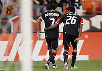 WASHINGTON, DC. - AUGUST 22, 2012:  Dwayne DeRosario (7) and Lionard Pajoy (26) of DC United celebrate after Dwayne DeRosario (7) had scored against the Chicago Fire during an MLS match at RFK Stadium, in Washington DC,  on August 22. United won 4-2.