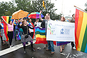 N.C. Pride Parade participants from Duke's Divinity School wave to parade protesters in Durham on Saturday, Sept. 29, 2012, at the corner of Main and Broad streets.