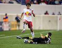 Josh Gardner (31) of the Columbus Crew tackles the ball away from Mehdi Ballouchy (10) of the New York Red Bulls during the game at Red Bull Arena in Harrison, NJ.  The New York Red Bulls tied the Columbus Crew, 1-1.