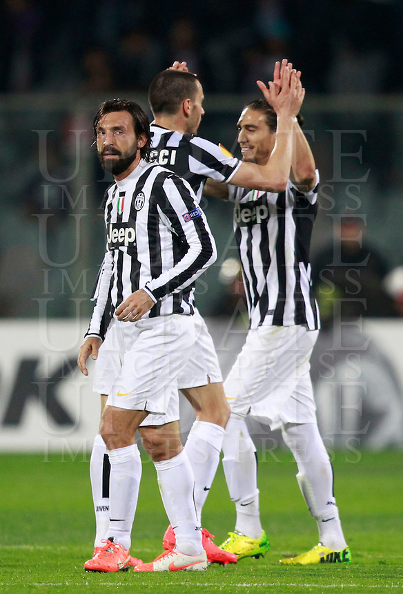 Calcio, ritorno degli ottavi di finale di Europa League: Fiorentina vs Juventus. Firenze, stadio Artemio Franchi, 20 marzo 2014. <br /> From left, Juventus Andrea Pirlo, Leonardo Bonucci and Martin Caceres celebrate at the end of the Europa League round of 16 second leg football match between Fiorentina and Juventus at Florence's Artemio Franchi stadium, 20 March 2014. Juventus won 1-0 to advance to the quarter-finals.<br /> UPDATE IMAGES PRESS/Isabella Bonotto