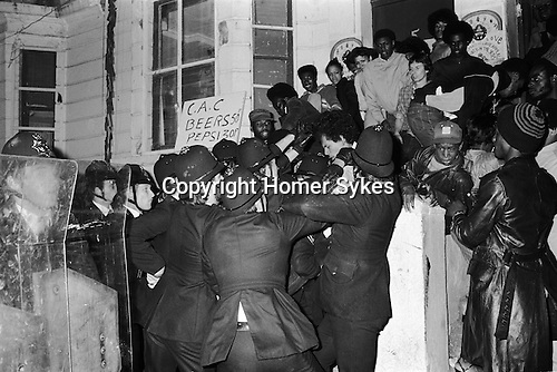 Police raid private house, All Saints Road during the Notting Hill Carnival London UK 1979.