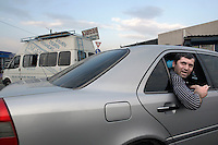 A man leans out of a car window in Tbilisi.