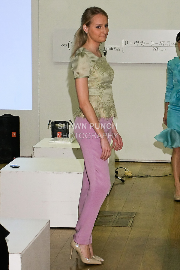85 Broads member walks runway in a SS12 Olivia chantelle lace top and Ss12 Keggan pants by Yuna Yang, during the 85 Broads Presents Yuna Yang trunk show at Art Gate Gallery on October 24th 2011.