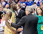Mar. 28, 2015; Notre Dame president Rev. John Jenkins, C.S.C. greets Jerian Grant (22) after the 2015 NCAA Tournament regional final against Kentucky. (Photo by Matt Cashore/University of Notre Dame)