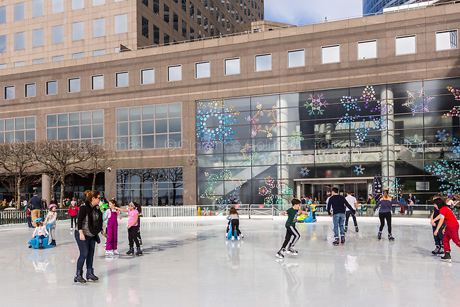 Ice skaters enjoy the Rink at Brookfield Place on a warm winter day in New York City.