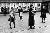 Female commuters wating at Fenchurch Street train station, London.