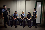 Police Pacification Unit (UPP) officers prepare and on patrol in Complexo do Caju, a complex of a newly pacified favelas in the North Zone, Rio de Janeiro, Brazil, on Saturday, April 27, 2013. <br /> <br /> In the early hours of Sunday, March 3, 2013, about 1,400 Brazilian security forces occupied 13 communities during a joint public security operation to install a Pacifying Police Unit (UPP) in two Rio de Janeiro favelas, Complexo do Caju and Barreira do Vasco. Elite police units backed by armored military vehicles and helicopters invaded the neighborhood in an on-going policing program aimed to drive violent and heavily armed drug gangs out of Rio's poor communities, where the traffickers have ruled for decades. For the community of Caju, that is ADA (Amigos de Amigos).