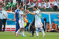 Sergio Aguero of Argentina is taken off injured and replaced by Ezequiel Lavezzi