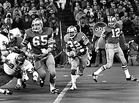 San Francisco 49ers vs the Kansas City Chiefs, #65 Randy Beisler blocking for #22 Vic Washington after hand off from QB John Brodie.<br />