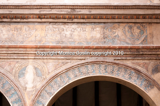 Detailed photo of faded frescos on a building in Mantua, Italy.
