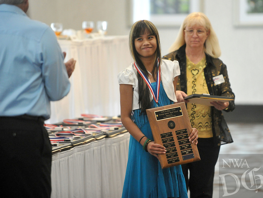 """NWA Democrat-Gazette/Michael Woods --04/22/2015--w@NWAMICHAELW... George Junior High student Caroline Koniske smiles as she receives her award during the 29th Annual """"Good Hearts"""" Youth Excellence Awards presented by the Fayetteville Sequoyah Kiwanis Wednesday afternoon at the Hilton Garden Inn in Fayetteville."""