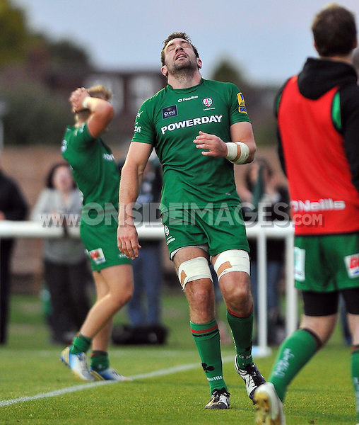 Tom Guest looks up in frustration after knocking the ball on over the line. Pre-season friendly match, between London Irish and Bristol Rugby on August 22, 2014 at Hazelwood in Middlesex, England. Photo by: Patrick Khachfe / JMP
