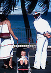 Family looking towards French warship. Noumea. South Pacific. 1980