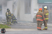 Joliette firemen at the scene of a flower boutique fire