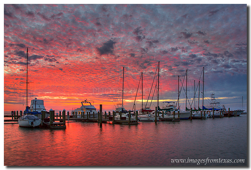 This Rockport image comes from a beautiful October sunrise. When I first arrived at this location along the Texas Gulf Coast, the clouds were pretty thick to the west and I didn't have much expectations for sunrise. However, thirty minutes later, the clouds began to turn and an orange paintbrush moved across the Texas sky. The colors didn't last long, but while they lingered, the scene was beautiful.
