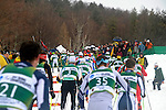 11 MAR 2011: The field climbs a short hill in front of the crowd the men's 20km Classical Cross Country race during the 2011 NCAA Men and Women's Division I Skiing Championship held Stowe Mountain Resort and Trapp Family Lodge in Stowe, VT. ©Brett Wilhelm/NCAA Photos