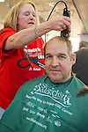 PETE MAGNUSON,  Calhoun High School teacher and coordinator of its St. Baldrick's head shaving event, is getting his head shaved for charity. Calhoun exceeded its goal of raising $50,000 for childhood cancer research. Plus, many ponytails cut off will be donated to Locks of Love foundation, which collects hair donations to make wigs for children who lost their hair due to medical reasons.