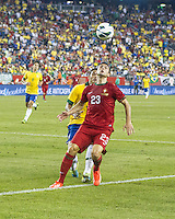 Portugal forward Helder Postiga (23) controls a high ball in front of Brazil defender Thiago Silva (3).  In an International friendly match Brazil defeated Portugal, 3-1, at Gillette Stadium on Sep 10, 2013.