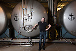 Keith Greggor, president and CEO of Anchor Brewers & Distillers outside beer tanks at the Anchor Steam brewery in San Francisco, Calif.