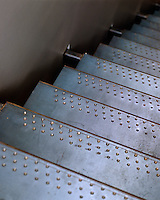 Industrial steel treads on this contemporary open-plan staircase
