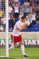 Kenny Cooper (33) of the New York Red Bulls celebrates scoring the game's only goal in the 7th minute. The New York Red Bulls defeated the Houston Dynamo 1-0 during a Major League Soccer (MLS) match at Red Bull Arena in Harrison, NJ, on May 09, 2012.