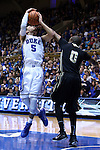 30 November 2014: Duke's Tyus Jones (5) is fouled by Army's Maxwell Lenox (0). The Duke University Blue Devils hosted the West Point Military Academy Army Black Knights at Cameron Indoor Stadium in Durham, North Carolina in a 2014-16 NCAA Men's Basketball Division I game. Duke won the game 93-73.
