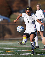 College of St Rose forward Jourdan Thompson (13) volley pass.. In 2012 NCAA Division II Women's Soccer Championship Tournament First Round, College of St Rose (white) defeated Wilmington University (black), 3-0, on Ronald J. Abdow Field at American International College on November 9, 2012.