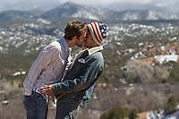 two men kissing outdoors in New Mexico