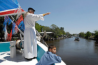 Father Rock, a Catholic priest from the community of Isle de Jean Charles, Louisiana performs the traditional blessing of the fleet in the Native American community of Pointe Aux Chene at the opening of shrimping season.