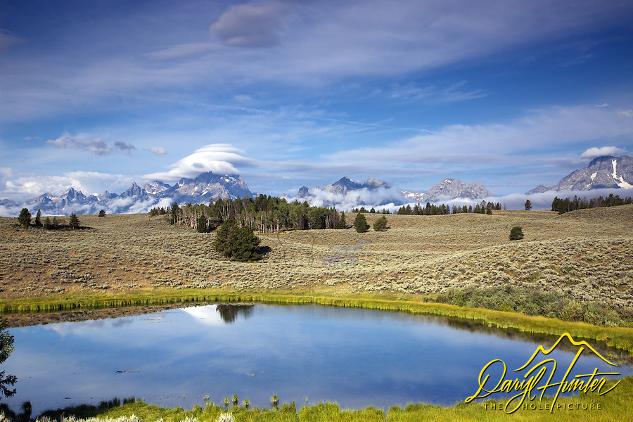 Lenticular  clouds over the Grand Tetons at Daryl's Pond in Grand Teton National Park