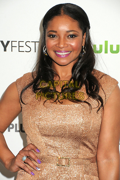 "Tamala Jones.PaleyFest 2012 Presents ""Castle"" held at The Saban Theatre, Beverly Hills, California, USA, 9th March 2012..half length gold dress hand on hip  belt  smiling .CAP/ADM/BP.©Byron Purvis/AdMedia/Capital Pictures."