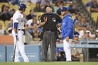 05/31/12 Los Angeles, CA: Los Angeles Dodgers outfielder Scott Van Slyke #33, Umpire Tony Randazzo and Los Angeles Dodgers manager Don Mattingly #8 during an MLB game between the Milwaukee Brewers and the Los Angeles Dodgers played at Dodger Stadium. The Brewers defeated the Dodgers 6-2.