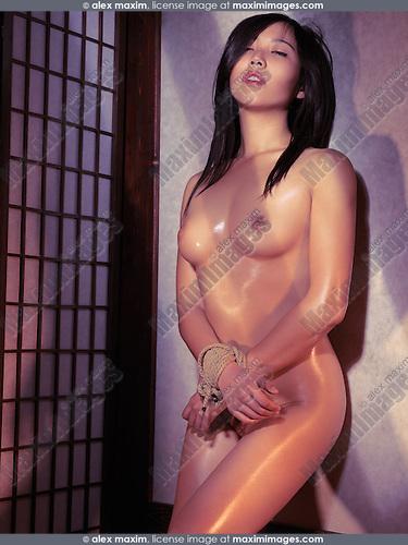 Naked Asian Woman Standing At A Wall With Tied Hands Bondage Shibari